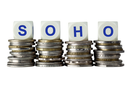 soho: Stacks of coins with the letters SOHO isolated on white background