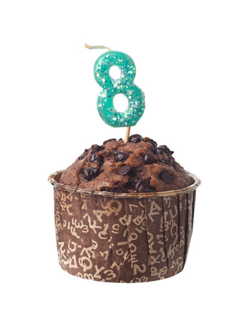 eight year old: Chocolate muffin with birthday candle for eight year old isolated on white background
