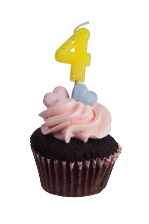aniversary: Mini cupcake with number four candle for four year aniversary isolated on white background