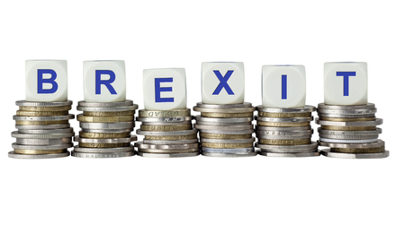portmanteau: Stacks of coins with the word BREXIT, refering to the possibility of Great Britain leaving the European Union