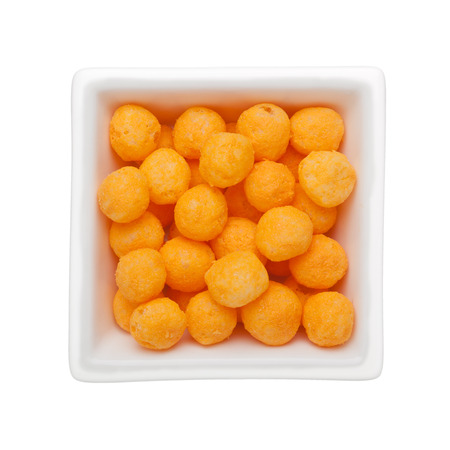 ball isolated: Cheese flavor corn snack in a square bowl isolated on white background
