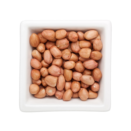 earthnut: Shelled peanuts in a square bowl isolated on white background Stock Photo