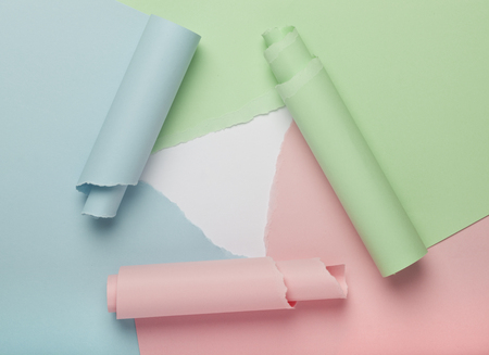 unveil: Torn colorful paper forming abstract background Stock Photo
