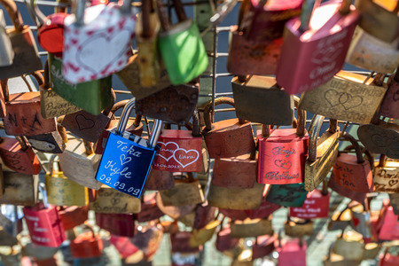 Padlocks of love at the bridge from subway Landungsbrücken to Elbpromenade, Hamburg, Germany, Europe.