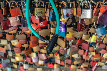 Love locks and a bicycle at the overpass from the subway Landungsbr?cken to the Elbe promenade in Hamburg.