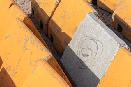 Close up on orange and concrete traffic barriers to protect pedestrians from vehicular terrorist attack.