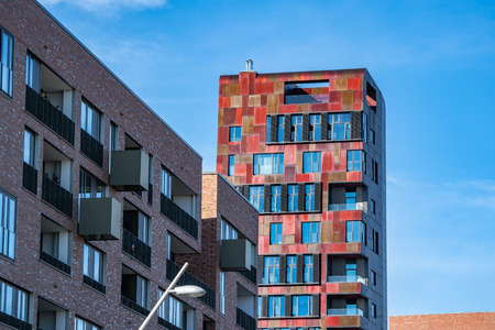 The red Cinnamon Tower at Osakaallee in the HafenCity of Hamburg, Germany, Europe.