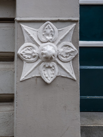 Detail of carved stone ornament on the exterior of a historical building in Sternschanze, Hamburg, Germany.