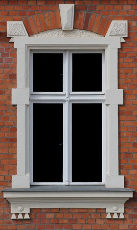 predominant:   A window in Greifswald, Mecklenburg-Vorpommern, Germany, representing the predominant architectual style of Brick Gothic