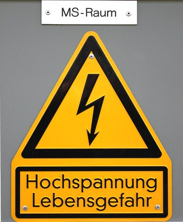 High voltage sign in Germany  The top line means Mittelspannungs-Raum  medium voltage area , the lower lines mean high voltage life danger   photo