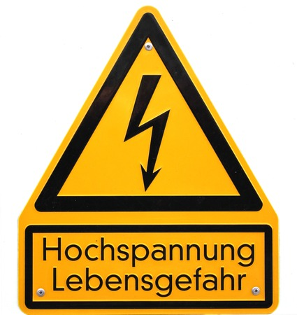 danger of life:   High voltage sign in Germany  The lower lines mean high voltage life danger