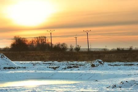 Radiant sun over industrial winter landscape in Greifswald, Mecklenburg-Vorpommern, Germany   photo