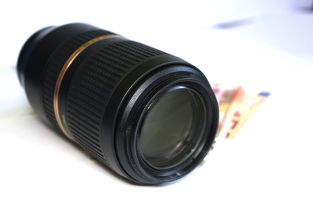 telezoom:   Tele-zoom lens and some paper money  Stock Photo