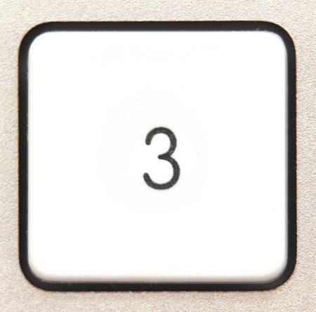 numpad:   Button 1 from a modern numpad. Stock Photo