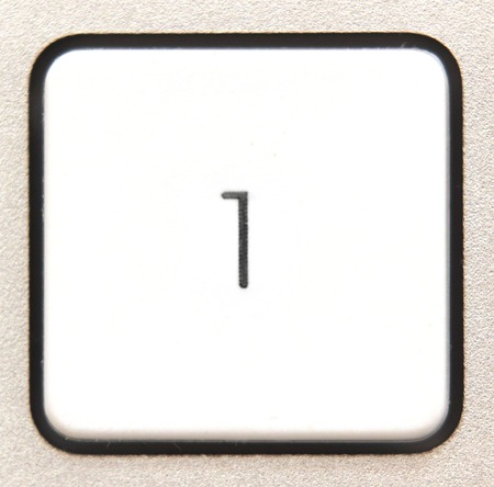 numpad:   Button 4 from a modern numpad. Stock Photo