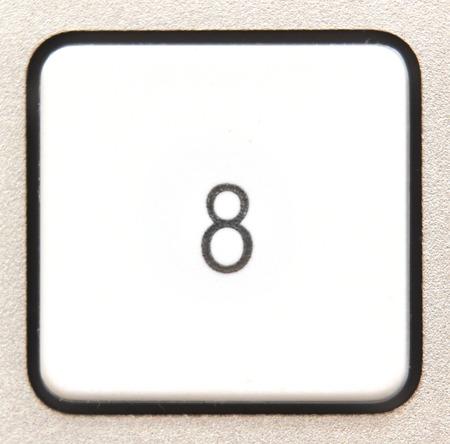 numpad:   Button 7 from a modern numpad. Stock Photo