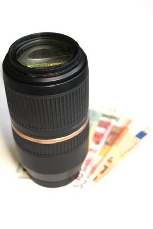 telezoom:   Tele-zoom lens and some paper money.