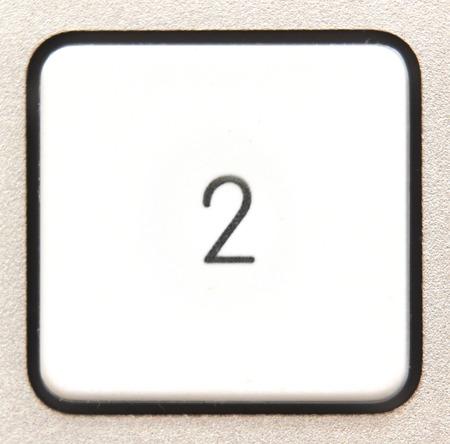 numpad:   Button 2 from a modern numpad. Stock Photo