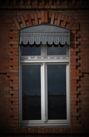 A window in Greifswald, Mecklenburg-Vorpommern, Germany, representing the predominant architectual style of Brick Gothic. Vignetting was added. Stock Photo