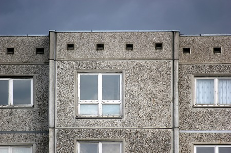 communists:   Part of a generic building reflecting the architectural style which was common in the GDR. Stock Photo