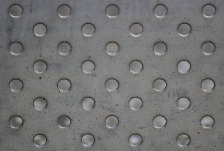 Background of metal panel with holes. photo