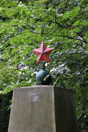 a memorial to fallen soldiers:   Red star on a memorial for the fallen russian soldiers in WWII, on a cemetary in Greifswald, Germany. Editorial