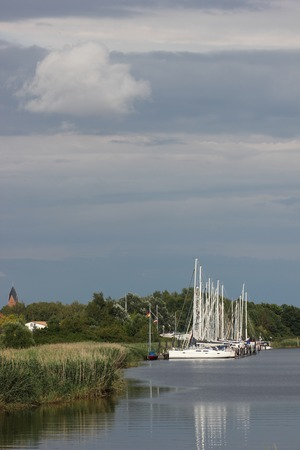 image created 21st century:   Sailing ships on the river Ryck, Mecklenburg-Vorpommern, Germany.