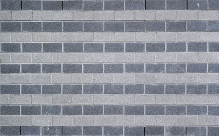 image created 21st century:   Wall made from rows of white and gray bricks usable as background or texture.