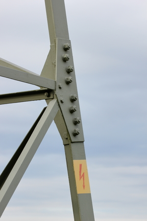electroshock:   High voltage sign on metal frame.