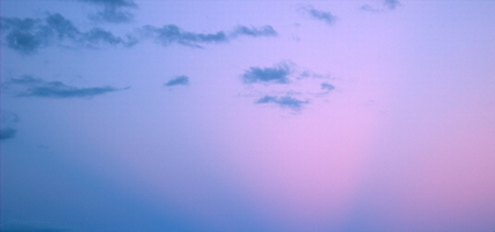 image created 21st century:   Evening cloudscape with red tint.