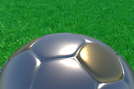 image created 21st century:   Realistic 3d rendering of a gold and silver football on green grass. Stock Photo