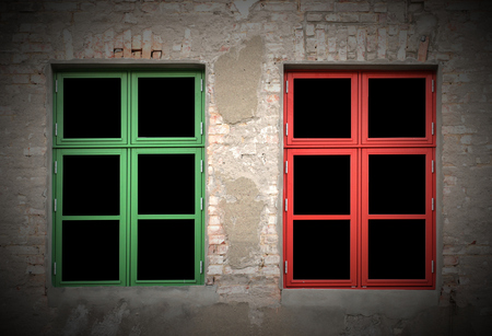 vignetting:   Colorful windows in a dilapidated house. Vignetting was applied. Stock Photo