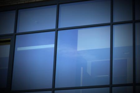 vignetting:   Modern window reflecting blue sky. Vignetting was applied.