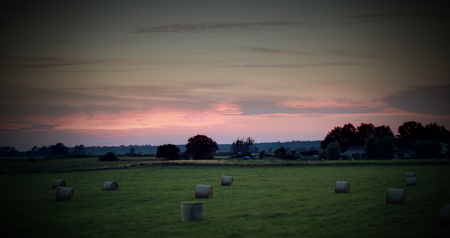 greifswald:   View on a meadow with hay bales near Greifswald, Mecklenburg-Vorpommern, Germany. The image was created using a HDR imaging technique. Vignetting was applied.