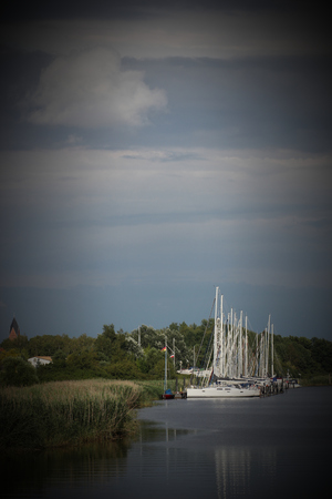 image created 21st century:   Sailing ships on the river Ryck, Mecklenburg-Vorpommern, Germany. Vignetting was applied.