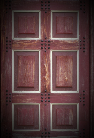 image created 21st century:   Texture of a wooden door with blanks. Vignetting was applied. Stock Photo