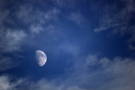 waxing gibbous:   Moon on dark sky with clouds. Stock Photo