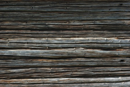 image created 21st century: Dark wooden texture of log cabin.