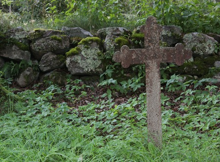 image created 21st century: Old iron cross as tombstone besides a church ruin in Sm�land, Sweden.