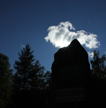 lith: Silhouette of standing stone on a hill near S�len, Dalarna, Sweden. Stock Photo
