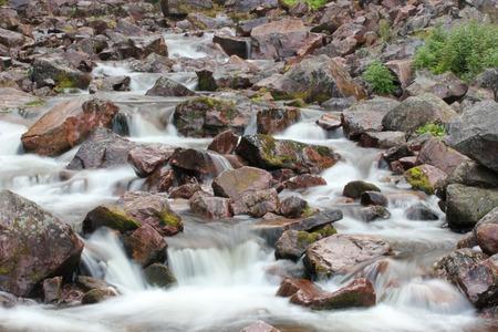r image: Rapids en la parte inferior de la cascada Njupeskr en el Parque Nacional Fulufjllet en Dalarna, Suecia. La imagen fue tomada con una larga exposici�n resultante en aguas tranquilas.