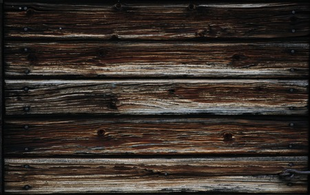 A dark wooden lath texture with rusty nails. photo