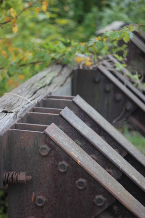 railtrack: Old stopper at the end of a railtrack with defocusing effect. Stock Photo