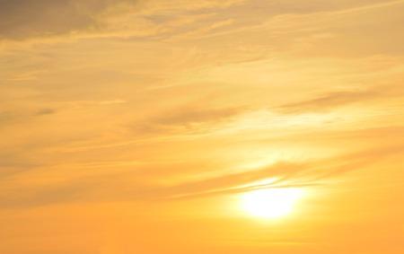 Vibrant orange sky with sun. photo