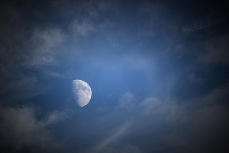 waxing gibbous: Moon on sky with clouds.
