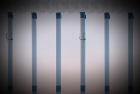 constancy: Smoke pipes with an equal height showing constancy with smoke added at the top.