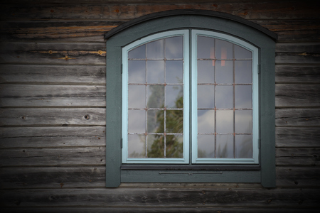 image created 21st century: Architectural detail (wall and window) of log house. Stock Photo
