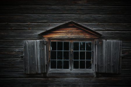 lumber industry: Dark wooden texture of log cabin with old window. Stock Photo