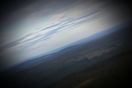 unusual angle: Unusual angle view on mountains from above the Njupesk�r waterfalls in Fulufj�llet National Park.