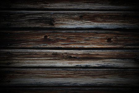 image created 21st century: A dark wooden lath texture with used areas and rusty nails.
